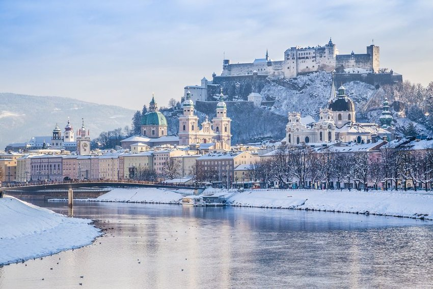 Historic city of Salzburg with Salzach river in winter during blue hour