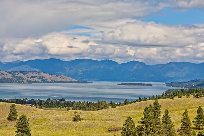 Flathead Lake in Montana with mountains in the background on a cloudy day