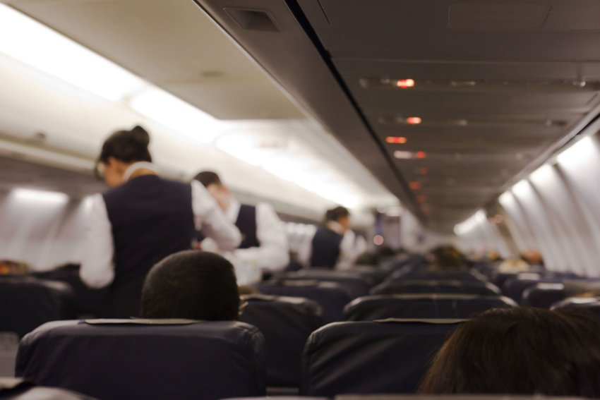 People inside a brightly lit airplane cabin