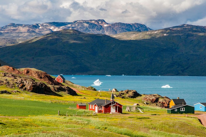 Village, bay, and mountain views in Greenland