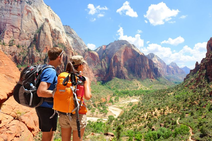 Two hikers looking off into a canyon in Zion National Park