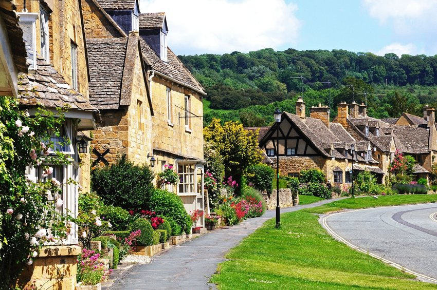 Picturesque cottages with flowers along the road of Worcestershire, United Kingdom