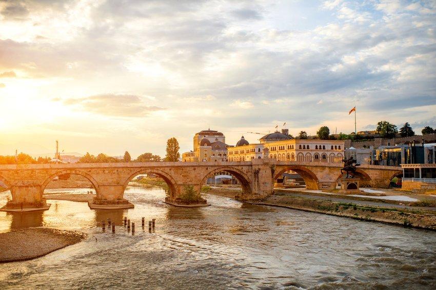 A stone bridge over a river in Skopje, a city in Macedonia.
