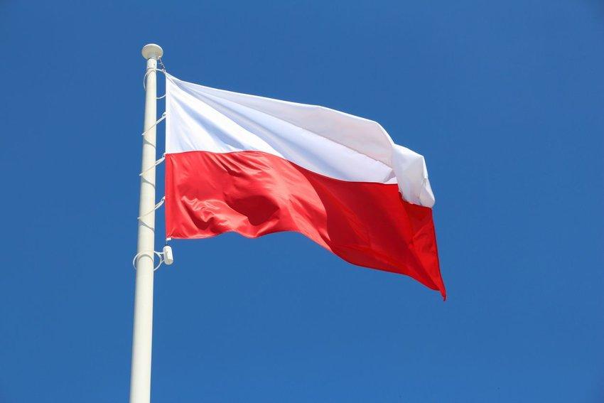 Polish flag against a blue sky
