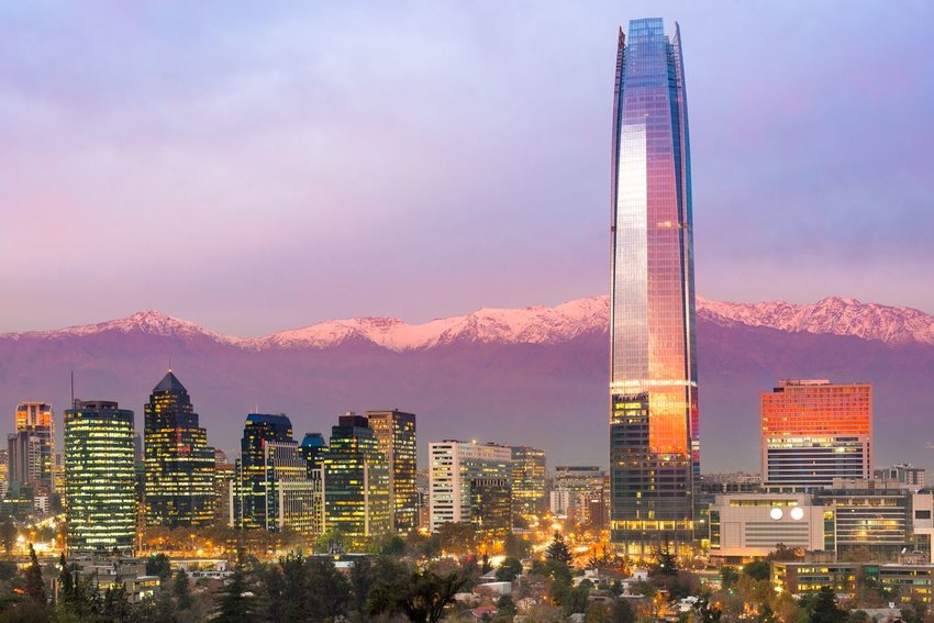 Skyline of Santiago, Chile at sunset with mountains in the background