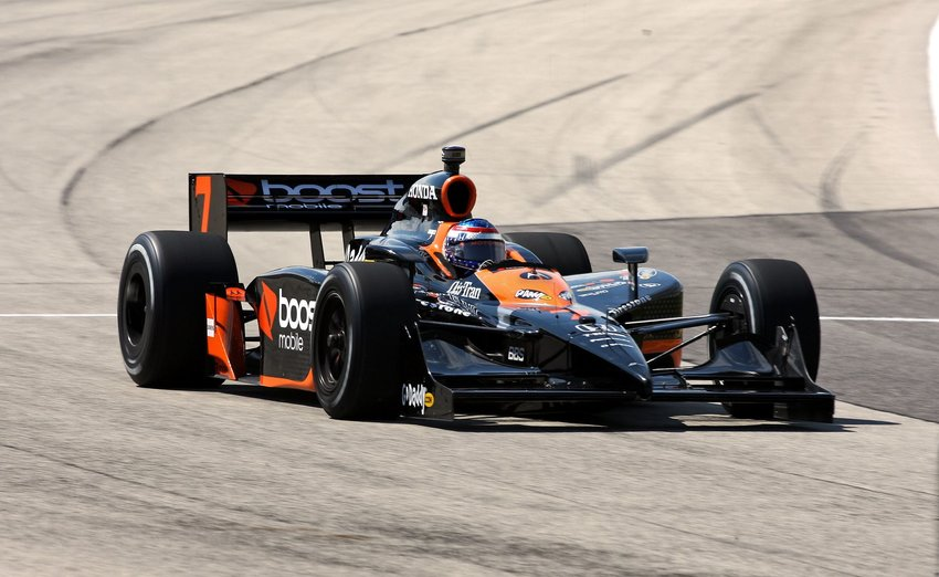 Danica Patrick driving her #7 Indy car through a corner at the Milwaukee Mile