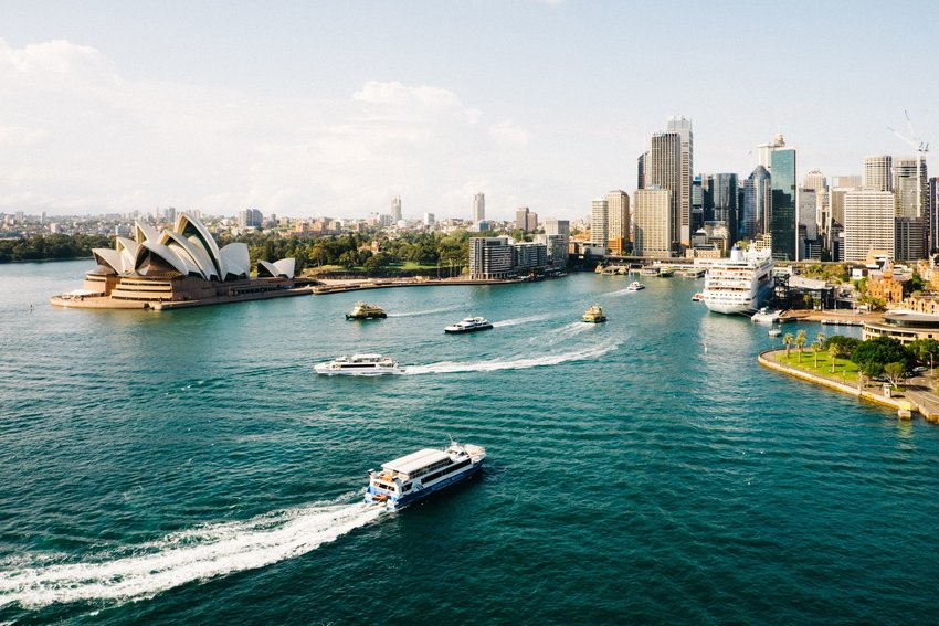 Sydney harbor with boats and view of the Sydney Opera House in Australia