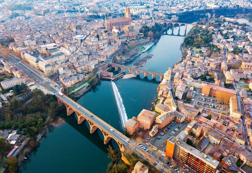 Aerial view of city of Albi, Cathedral Basilica of Saint Cecilia and Pont Vieux over river Tarn