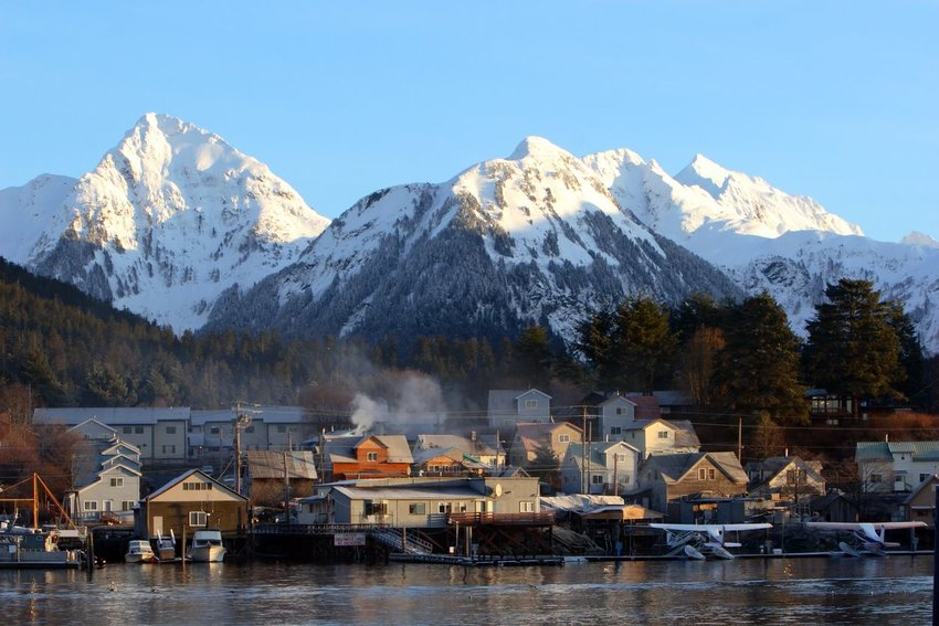 Alaskan town with mountains in the background