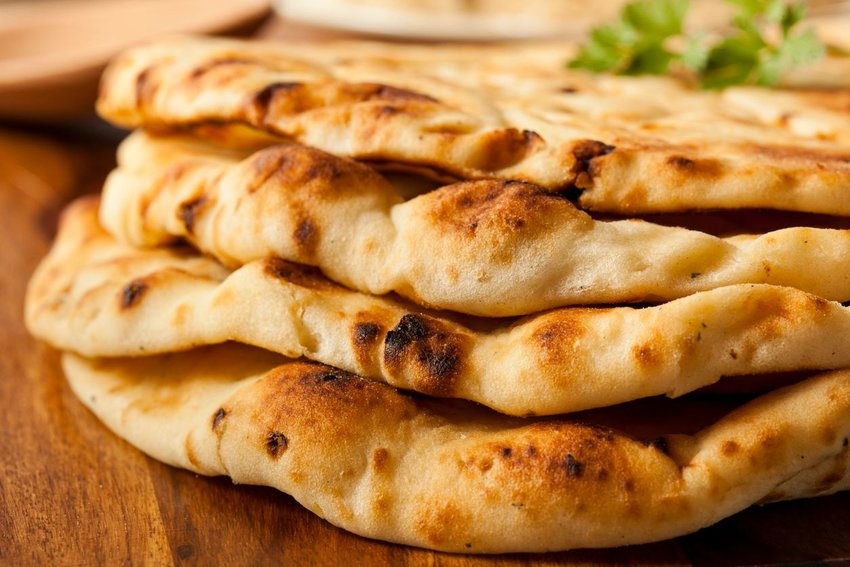 Stack of naan on a wooden table