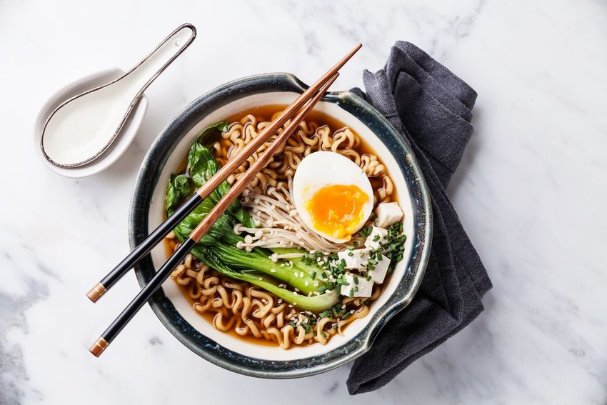 Bowl of ramen with chopsticks, shot from above