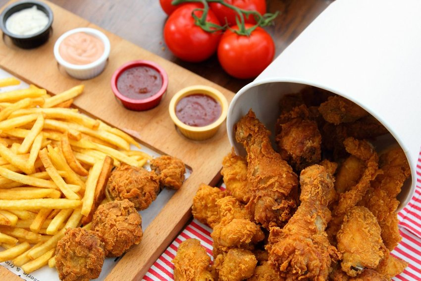 Fried chicken drumsticks with french fries and sauces