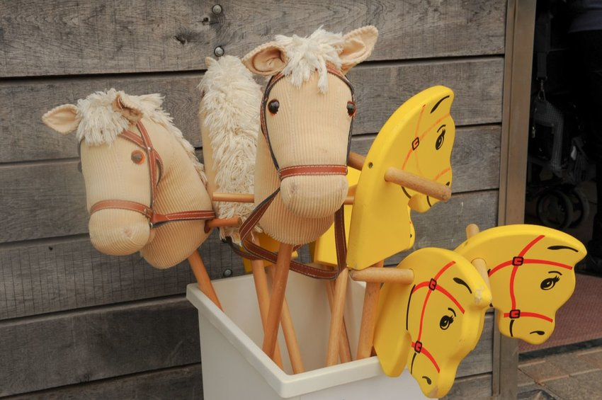 Toy horses in a basket