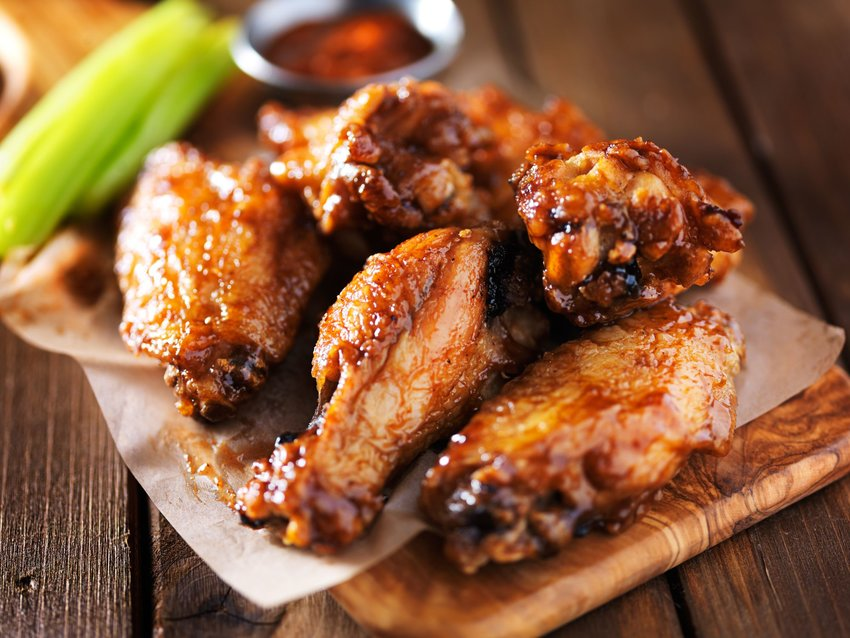 Chicken wings with buffalo sauce and celery sticks