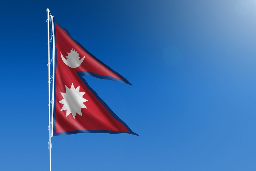 Nepal flag with blue sky in the background
