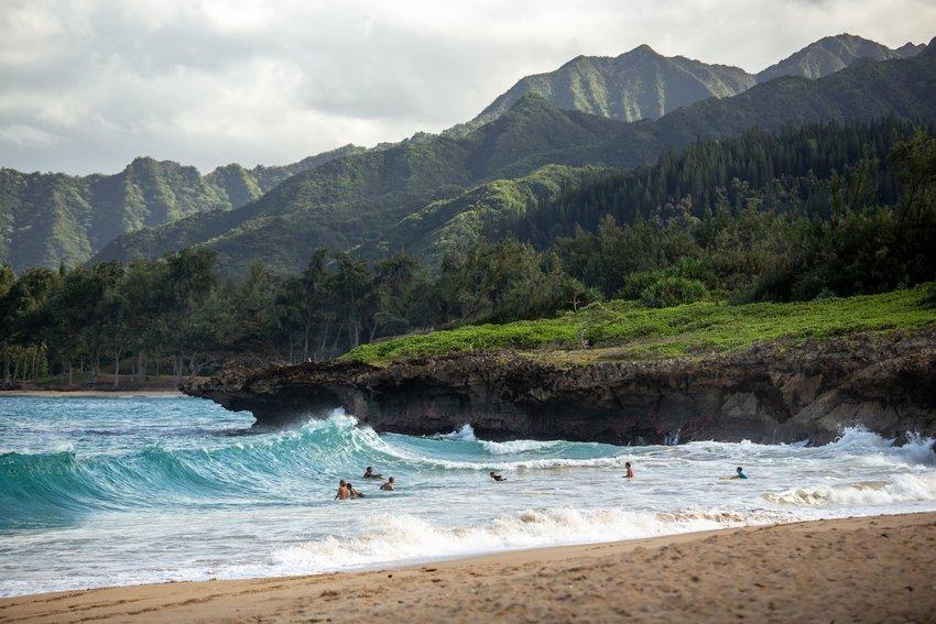 People surfing in the ocean off of Hawaii
