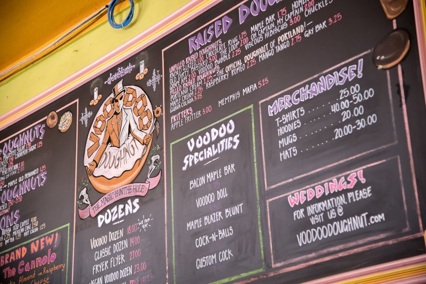 The Voodoo Doughnut menu, complete with a Weddings! information blurb in the corner.