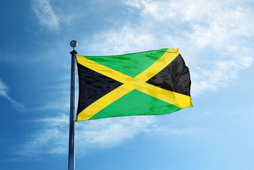 Jamaica flag waving in the wind on a flagpole