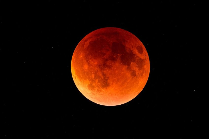 A blood moon in the dark night sky