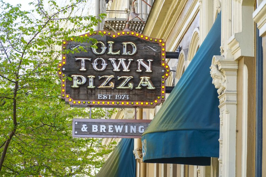 The front sign of Portland's haunted pizzeria, Old Town Pizza.
