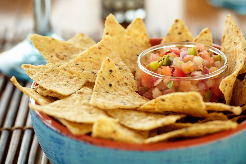 Chips and salsa in a blue bowl