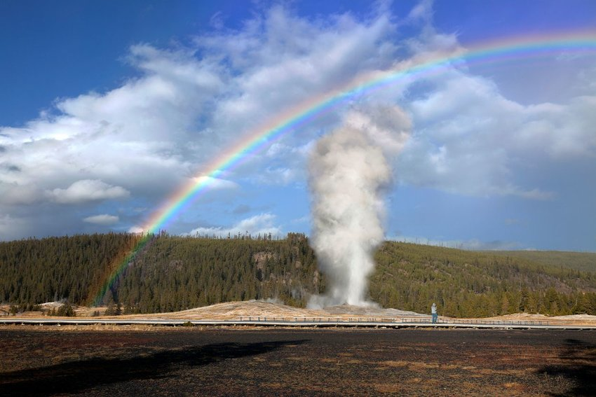 Old Faithful in Wyoming with a rainbow