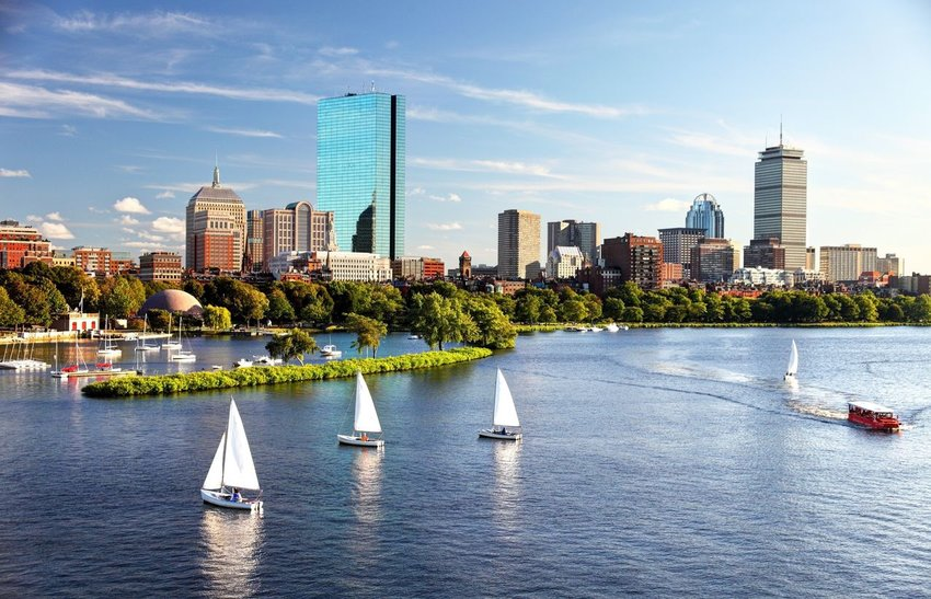 Sailboats on the Charles River with the city of Boston in the background