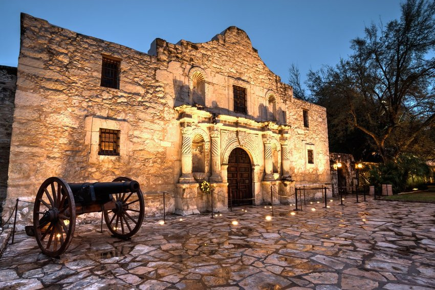 The Alamo at night lit up with lights