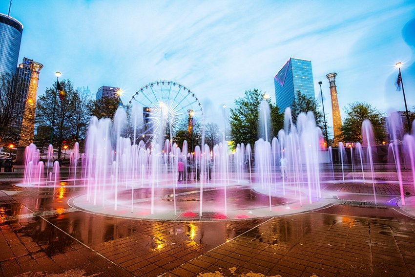 Centennial Olympic Park with fountain and ferris wheel in the background