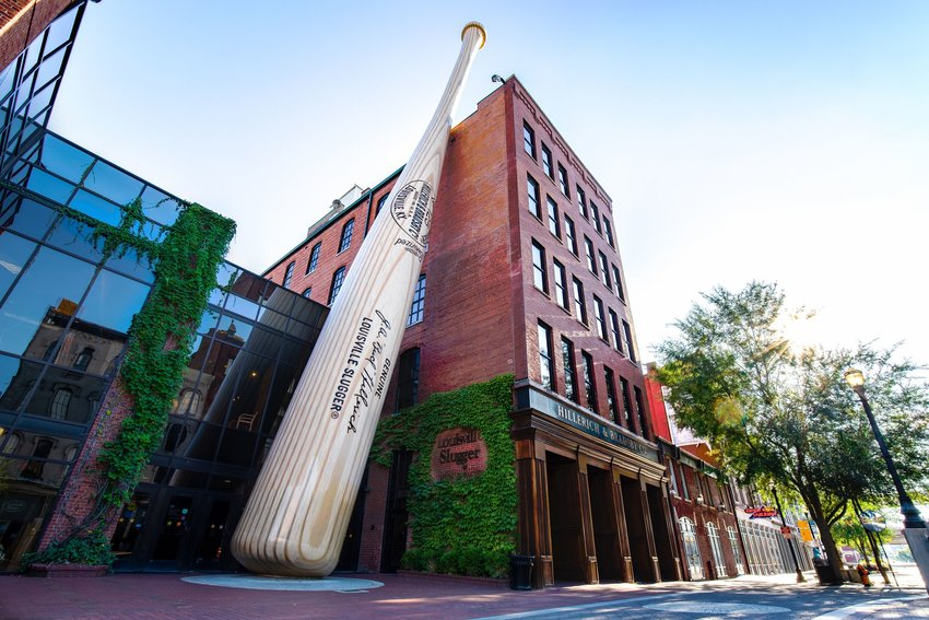 Louisville Slugger Museum and Factory with baseball bat statue leaning against brick building