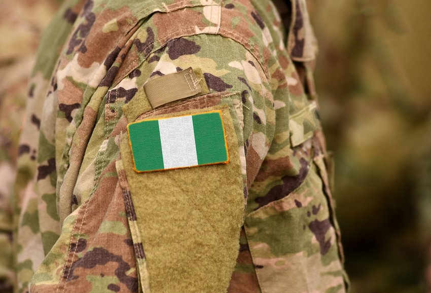 Person wearing camouflage with Nigerian flag on it