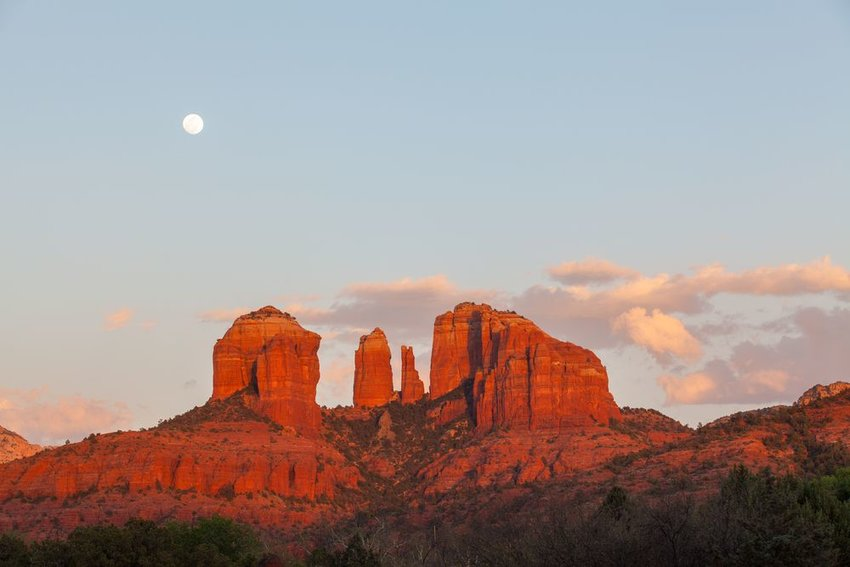 Red rocks of Sedona, Arizona with a full moon above