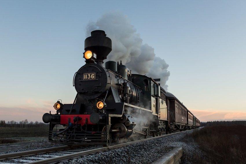 Black train going down the railroad