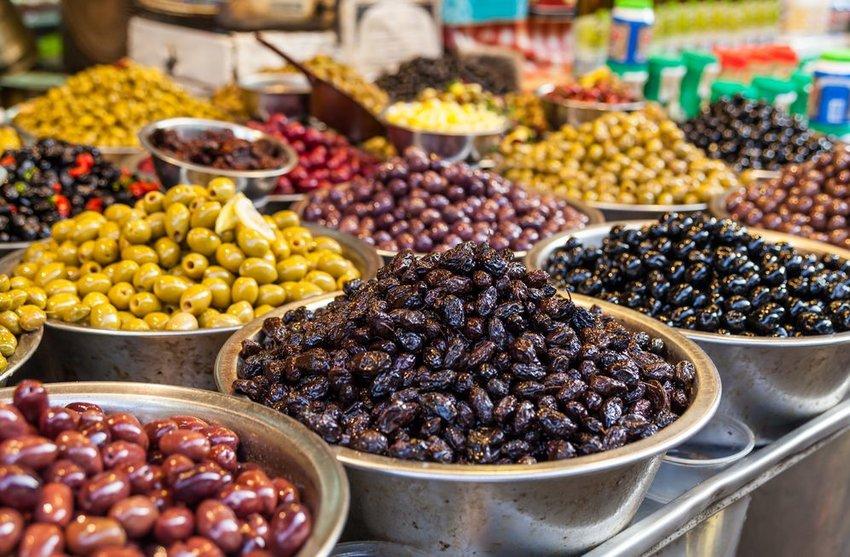 Green and black olives in a market Carmel, Tel Aviv, Israel