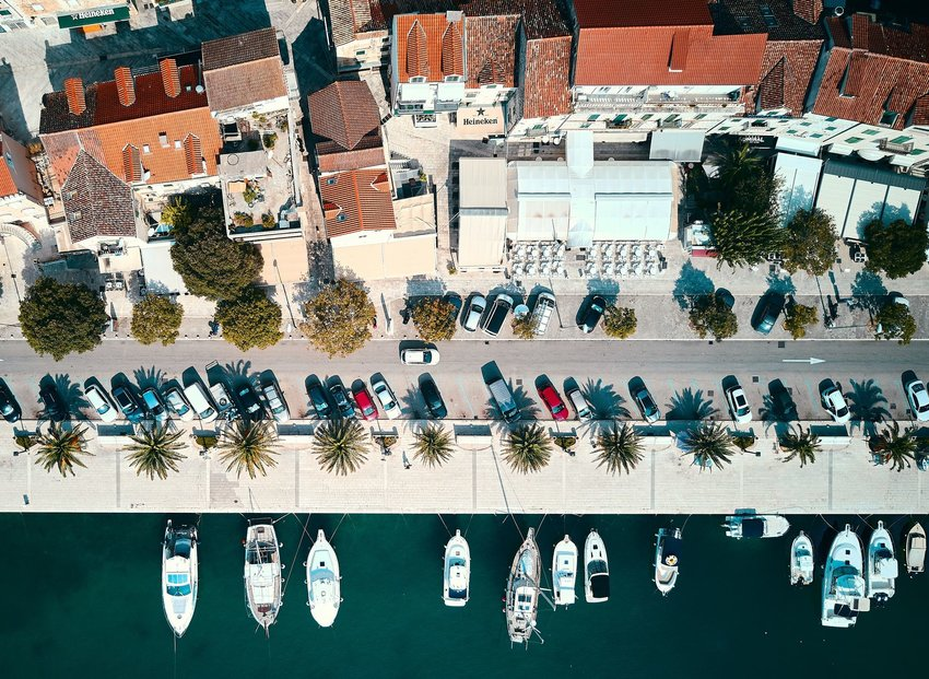 Aerial view of houses in Croatia and boats in the water