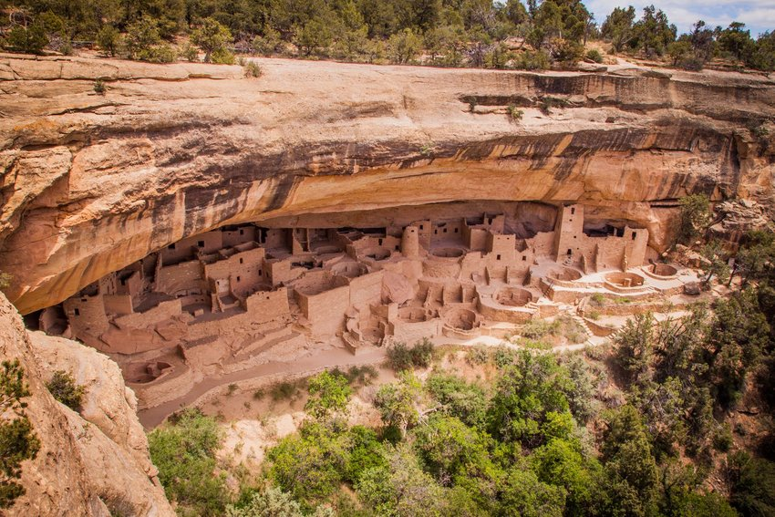 Ancient dwellings carved beneath a cliff at Mesa Verde National Park