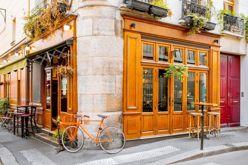 French storefront with bicycle parked out front