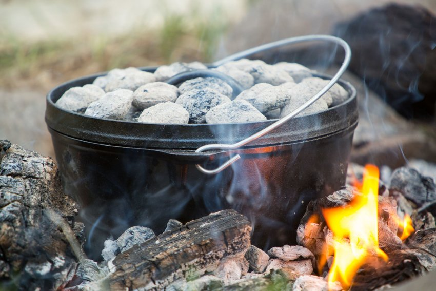 Traditional Dutch oven over campfire