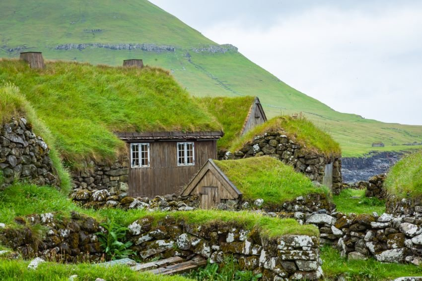 Grass-roof houses in small fishing village on Koltur