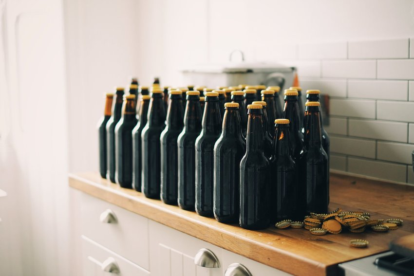 Bottles of beer on a kitchen counter