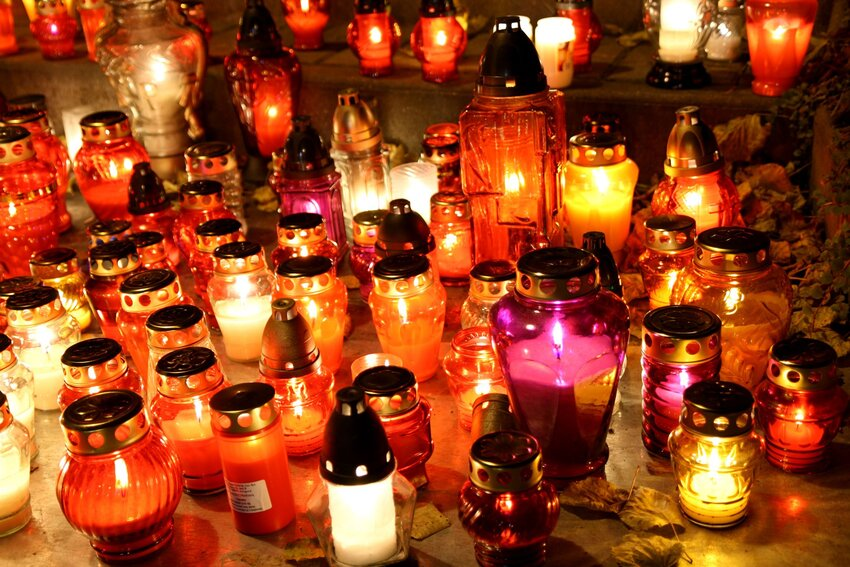Close-up of colorful candles lit for Zaduskzi