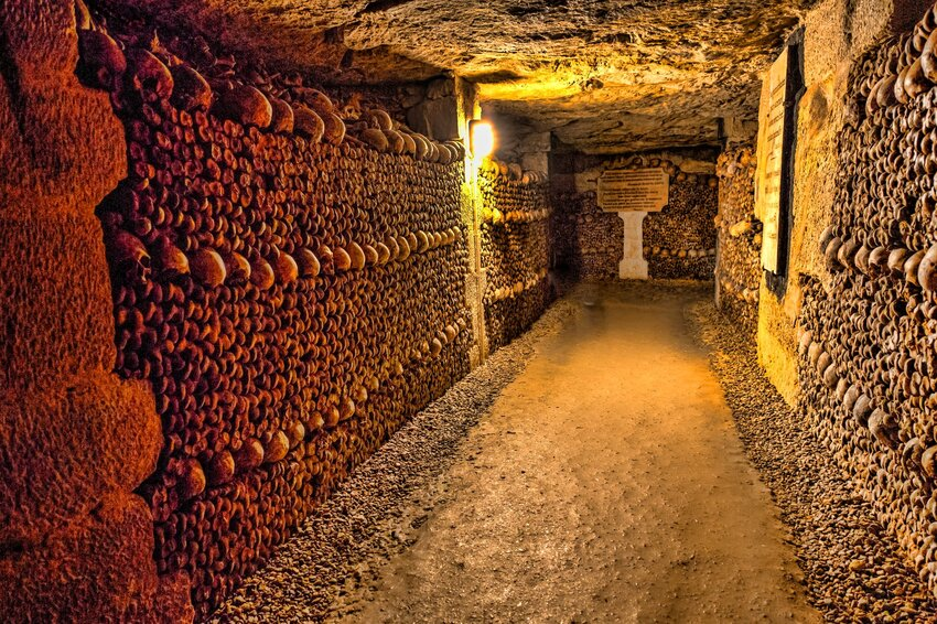 Rows of skeleton heads in the Catacombs of Paris
