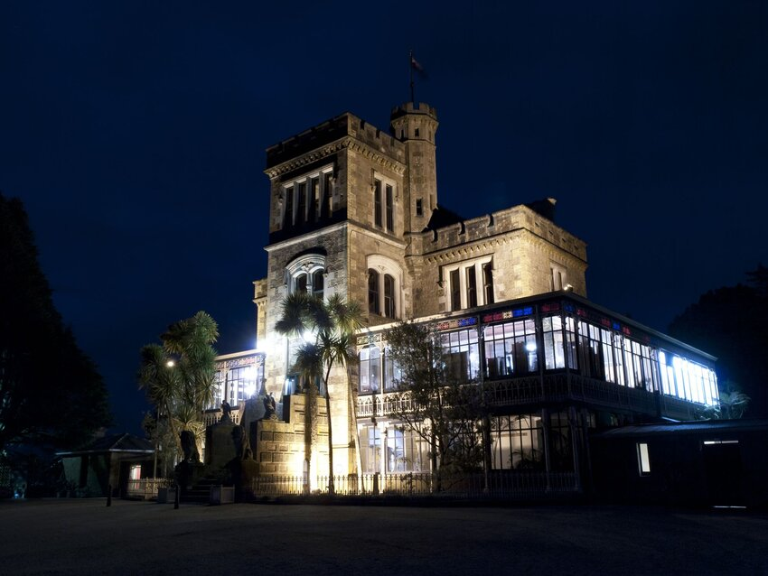 Larnarch Castle lit against dark night sky