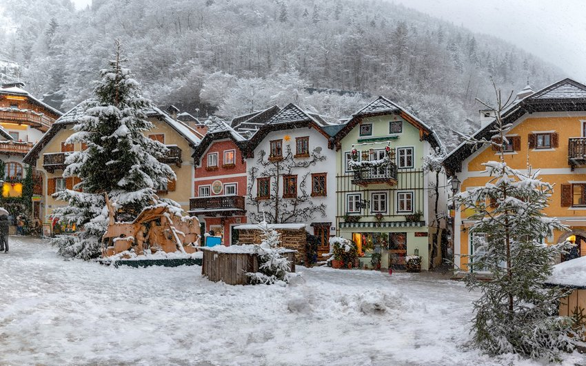 Snowy Austrian mountain village with traditional homes