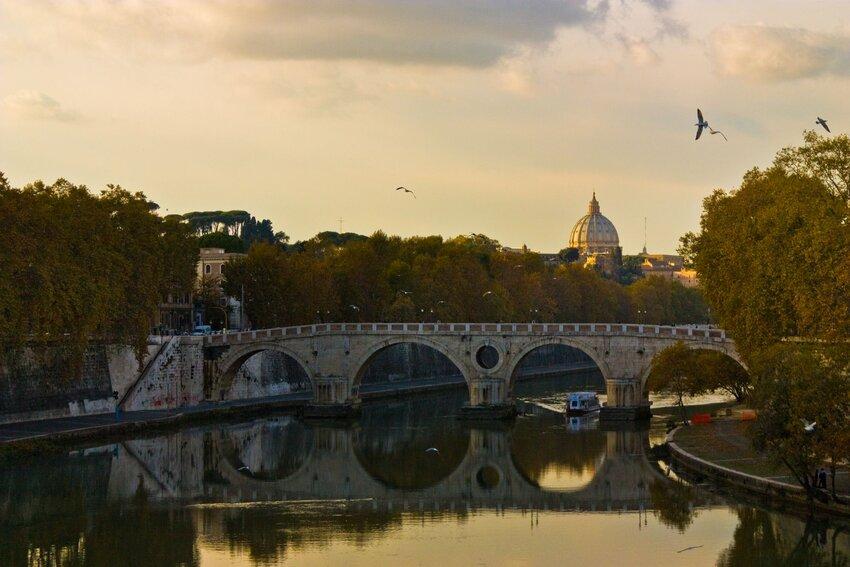 Ponte Sisto bridge over the River Tiber at dusk