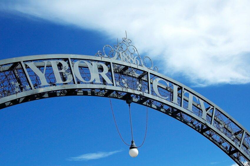 Entrance sign to Ybor City against blue sky