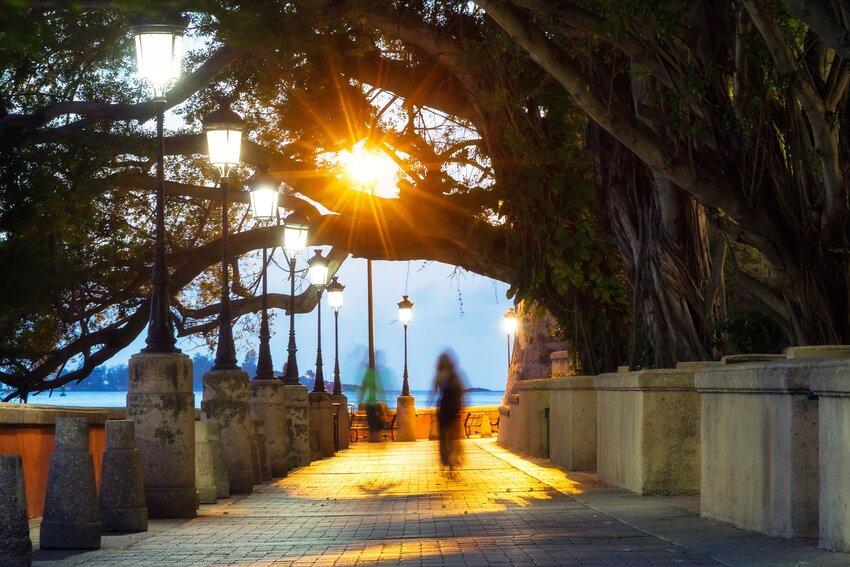 Person walks in San Juan, Puerto Rico at dusk
