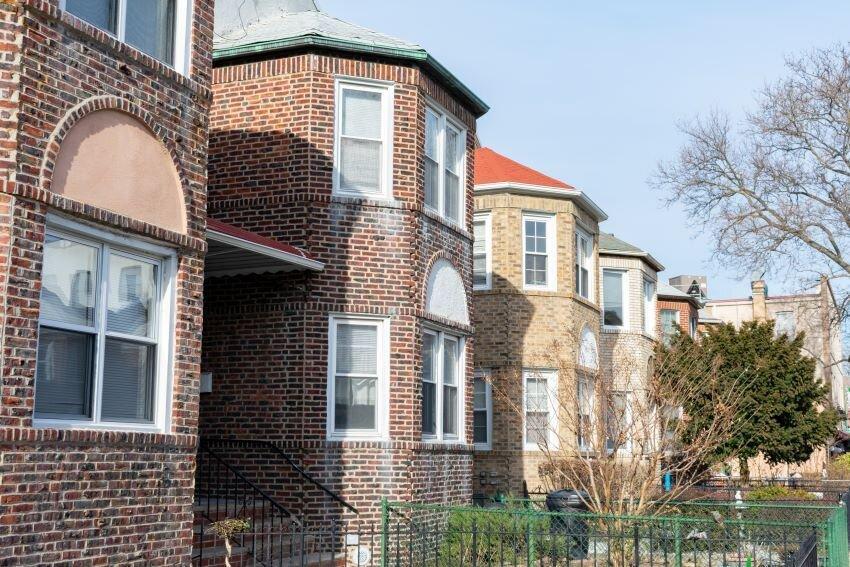 Row of Old Brick Homes in Astoria Queens New York.