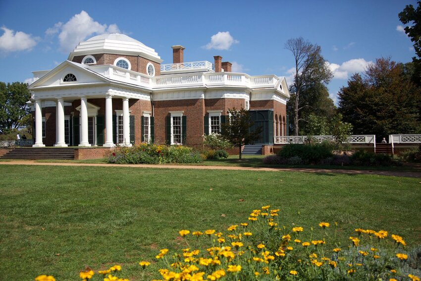 Thomas Jefferson's home in Monticello with yellow flowers in foreground