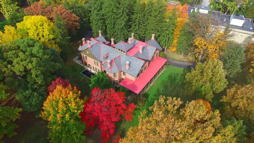 Aerial overview of Rutherford Hayes presidential library and historic home surrounded by autumn leaves